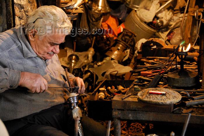 lebanon66: Lebanon, Sidon: artisan fixing a hookah water pipe in workshop - photo by J.Pemberton - (c) Travel-Images.com - Stock Photography agency - Image Bank