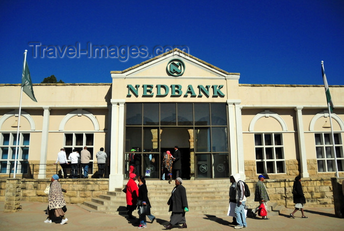 lesotho49: Maseru, Lesotho: people pass in front of Nedbank Lesotho building - Kingsway - photo by M.Torres - (c) Travel-Images.com - Stock Photography agency - Image Bank