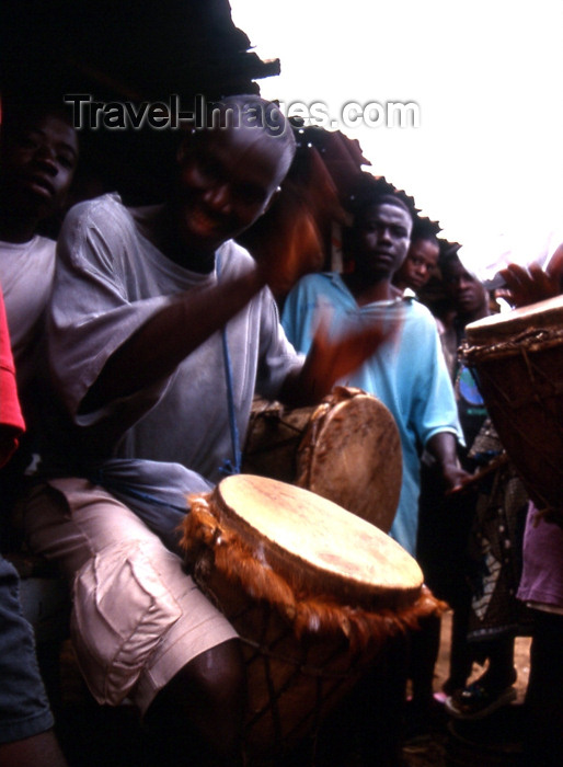 liberia26: Grand Bassa County, Liberia, West Africa: Buchanan - drummer - African musician - photo by M.Sturges - (c) Travel-Images.com - Stock Photography agency - Image Bank