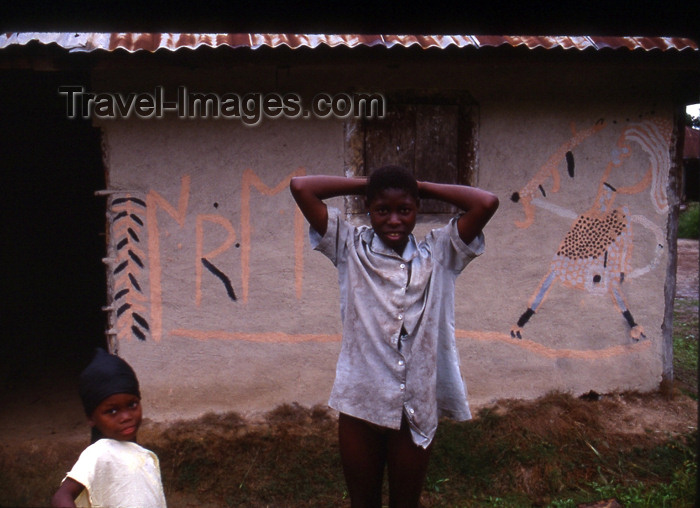 liberia34: Grand Bassa County, Liberia, West Africa: kids and painted façade - photo by M.Sturges - (c) Travel-Images.com - Stock Photography agency - Image Bank