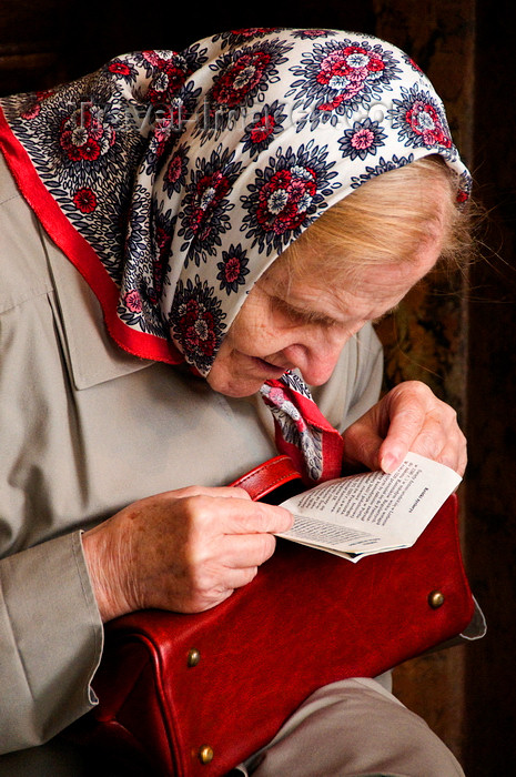 lithuania197: Vilnius, Lithuania: elderly woman reading the Bible in Chapel of the Blessed Mary - photo by J.Pemberton - (c) Travel-Images.com - Stock Photography agency - Image Bank