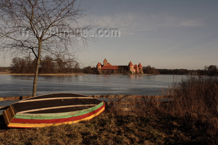 lithuania214: Trakai, Lithuania: Trakai Island Castle and boat resting on the shore of lake Galve - photo by A.Dnieprowsky - (c) Travel-Images.com - Stock Photography agency - Image Bank