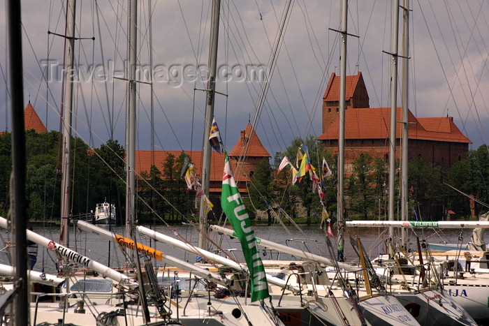 lithuania36: Lithuania - Trakai: masts - Galve Lake - yachts and Trakai castle - photo by A.Dnieprowsky - (c) Travel-Images.com - Stock Photography agency - Image Bank
