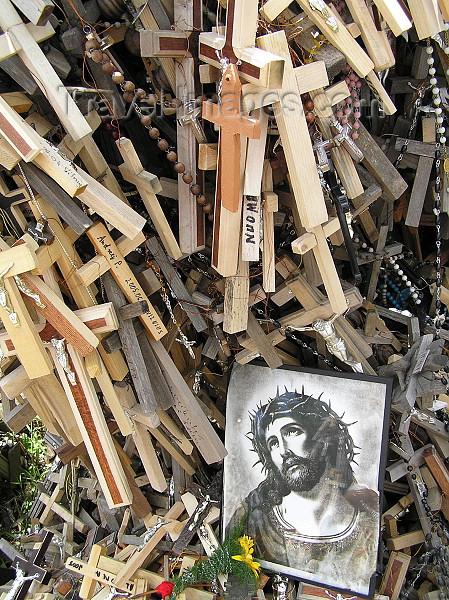 lithuania40: Lithuania / Litva - Siauliai: Hill of crosses - Kryžiu Kalnas - crosses and Jesus protrait - photo by J.Kaman - (c) Travel-Images.com - Stock Photography agency - Image Bank