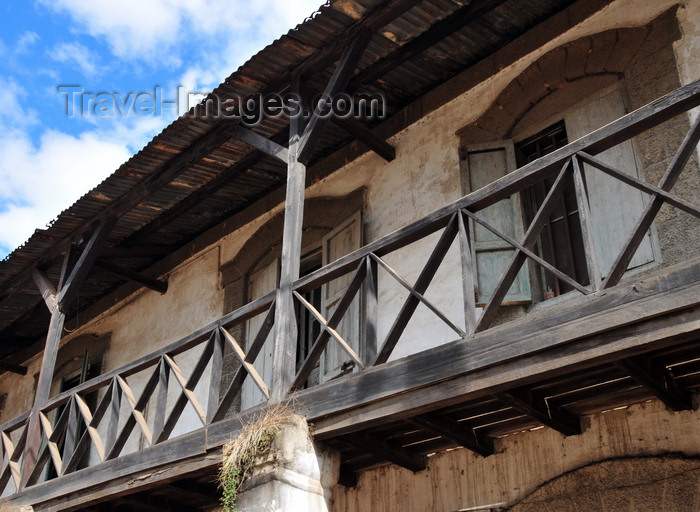 madagascar140: Moramanga, Alaotra-Mangoro, Toamasina Province, Madagascar: timber balcony - Malagasy architecture - photo by M.Torres - (c) Travel-Images.com - Stock Photography agency - Image Bank