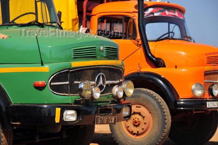madagascar211: Tsimafana, Belo sur Tsiribihina district, Menabe Region, Toliara Province, Madagascar: Mercedes-Benz trucks wait for the ferry - photo by M.Torres - (c) Travel-Images.com - Stock Photography agency - Image Bank