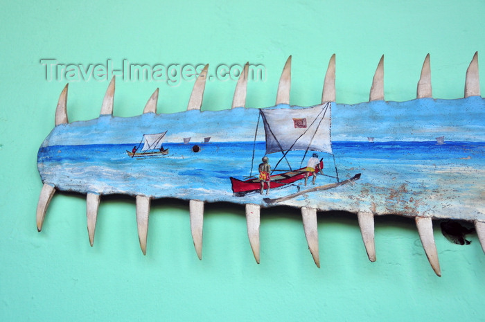 madagascar218: Belo sur Tsiribihina, Menabe Region, Toliara Province, Madagascar: painting on the toothy snout of a sawfish - fishing scene - fishermen set to sea on outrigger canoes - Malagasy art - Pristis microdon - photo by M.Torres - (c) Travel-Images.com - Stock Photography agency - Image Bank