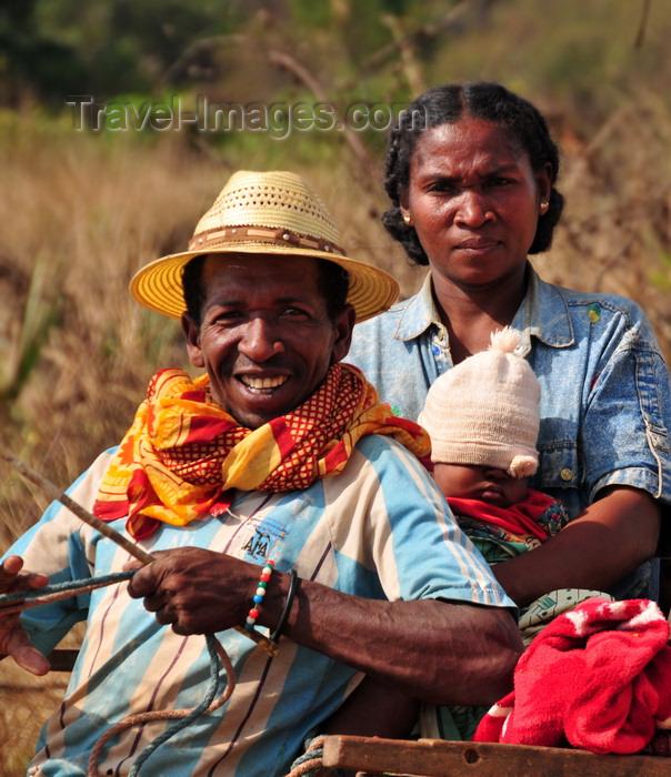 madagascar250: West coast road between the Manambolo river and Belon'i Tsiribihina, Toliara Province, Madagascar: Malagasy family - couple and baby on a cart - photo by M.Torres - (c) Travel-Images.com - Stock Photography agency - Image Bank