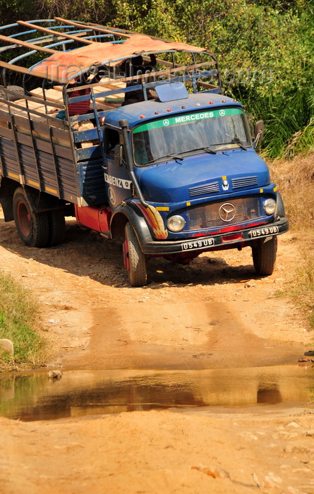 madagascar256: West coast road between the Manambolo river and Belon'i Tsiribihina, Toliara Province, Madagascar: a Taxi Brousse negotiates a small river - Mercedes-Benz truck  - photo by M.Torres - (c) Travel-Images.com - Stock Photography agency - Image Bank