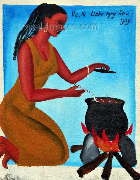 madagascar260: West coast road between the Tsiribihina river and Alley of the Baobabs, Toliara Province, Madagascar: traditional tomb - woman preparing a meal - photo by M.Torres - (c) Travel-Images.com - Stock Photography agency - Image Bank