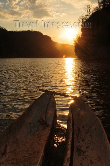 madagascar280: Antsalova district, Melaky region, Mahajanga province, Madagascar: Manambolo River - double dugout canoe and the rising sun - photo by M.Torres - (c) Travel-Images.com - Stock Photography agency - Image Bank