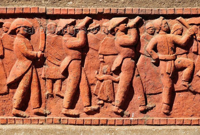 madagascar411: Antananarivo / Tananarive / Tana - Analamanga region, Madagascar: soldiers on parade - bas-relief on a residence in the Haute Ville - photo by M.Torres - (c) Travel-Images.com - Stock Photography agency - Image Bank