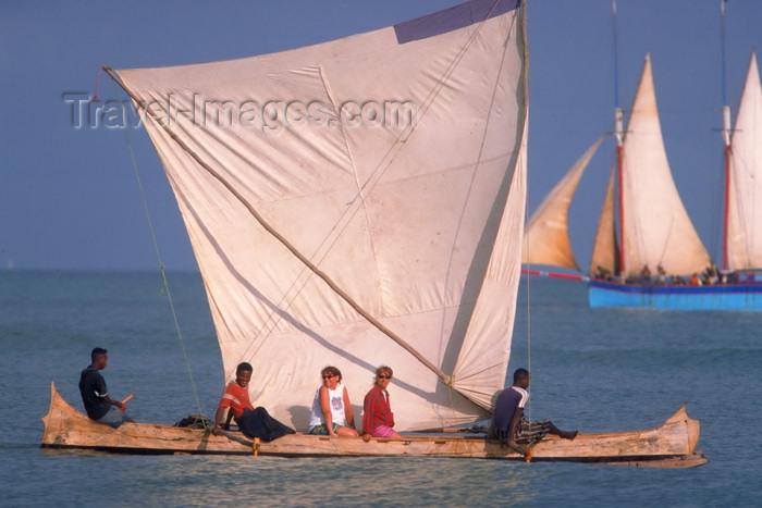 madagascar7: Morondava, Region of Menabe, province of Toliara, western Madagascar: tourists enjoy sailing on a traditional outrigger canoe - photo by R.Eime - (c) Travel-Images.com - Stock Photography agency - Image Bank