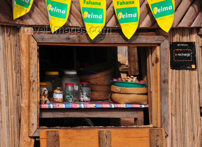 madagascar72: Vohilava, Île Sainte Marie / Nosy Boraha, Analanjirofo region, Toamasina province, Madagascar: products at the local general store, from food to communications - Telma banners - photo by M.Torres - (c) Travel-Images.com - Stock Photography agency - Image Bank