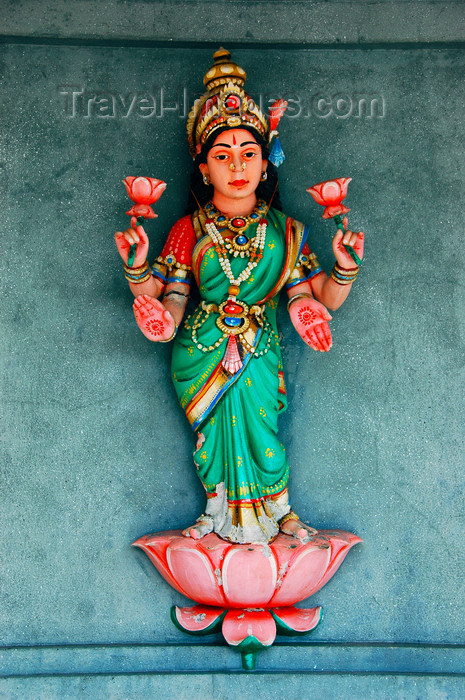 mal447: Kali Amman Temple - Sri Devi on a lotus, Pulau Pankor Island, Malaysia.   photo by B.Lendrum - (c) Travel-Images.com - Stock Photography agency - Image Bank