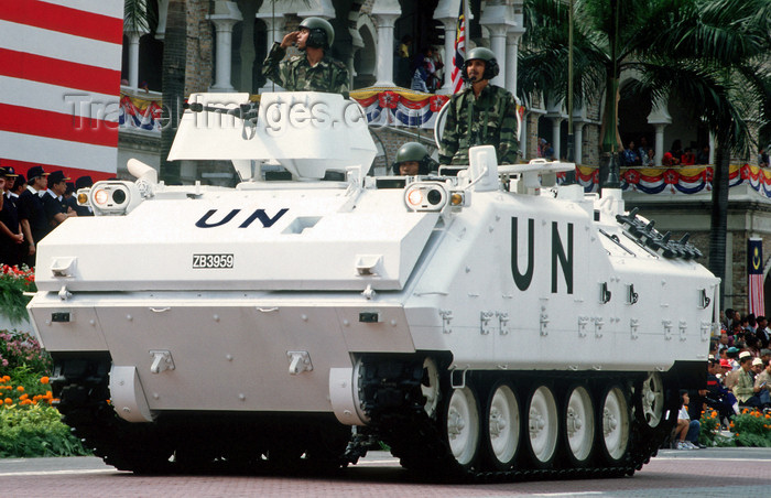 mal476: National day military parade - APC - MIFV K200 South Korean infantry fighting vehicle in UN colours, Kuala Lumpur, Malaysia - photo by B.Lendrum - (c) Travel-Images.com - Stock Photography agency - Image Bank