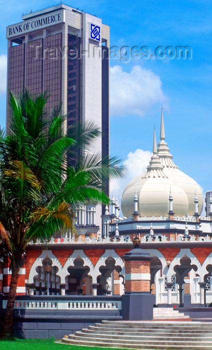 mal481: Masjid Jamek mosque and the Bank of Commerce building - city center, Kuala Lumpur, Malaysia - photo by B.Lendrum - (c) Travel-Images.com - Stock Photography agency - Image Bank