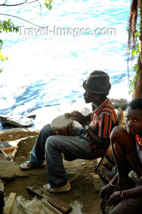 malawi7: Nkhata Bay, Lake Nyasa, Northern region, Malawi: drummer by the water - photo by D.Davie - (c) Travel-Images.com - Stock Photography agency - Image Bank