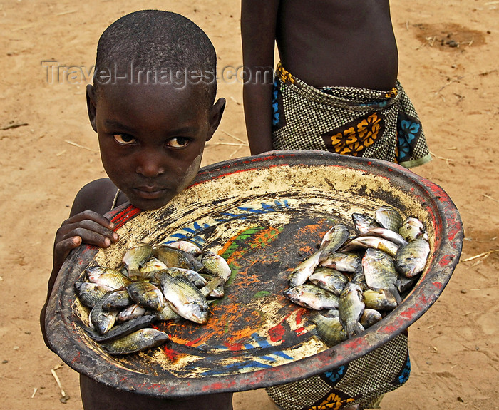 mali55: Djenné cercle, Mopti Region, Mali: boy selling river fish in village near Djenne - photo by J.Pemberton - (c) Travel-Images.com - Stock Photography agency - Image Bank