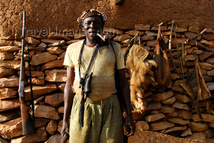 mali65: Bandiagara Escarpment, Dogon country, Mopti region, Mali: hunter with his weapon, pipe and trophies - photo by J.Pemberton - (c) Travel-Images.com - Stock Photography agency - Image Bank