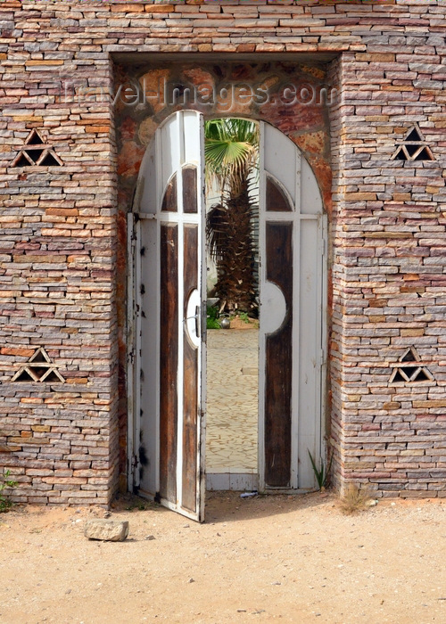 mauritania58: Nouakchott, Mauritania: building gate with traditional Mauritanian stone masonry - Fondation National Pour la Sauvegarde des Villes Anciennes - photo by M.Torres - (c) Travel-Images.com - Stock Photography agency - Image Bank