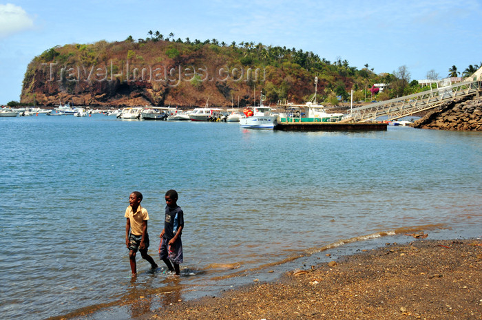 mayotte5: Mamoudzou, Grande-Terre / Mahore, Mayotte: kids walk along the beach - Pointe Mahabou in the background - photo by M.Torres - (c) Travel-Images.com - Stock Photography agency - Image Bank