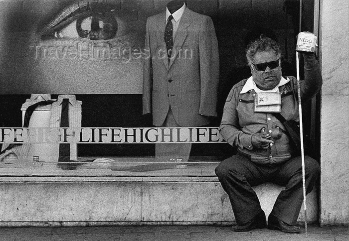 mexico352: Mexico City: High Life and blind  beggar - the black and white of Mexican life - photo by Y.Baby - (c) Travel-Images.com - Stock Photography agency - Image Bank