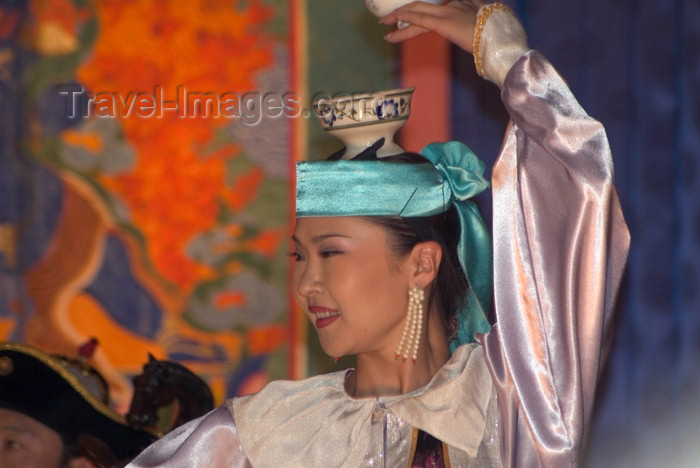 mongolia10: Mongolia - Ulaan Baator / ULN / Ulan Bator: folk evening - dancer with vase - photo by A.Summers - (c) Travel-Images.com - Stock Photography agency - Image Bank