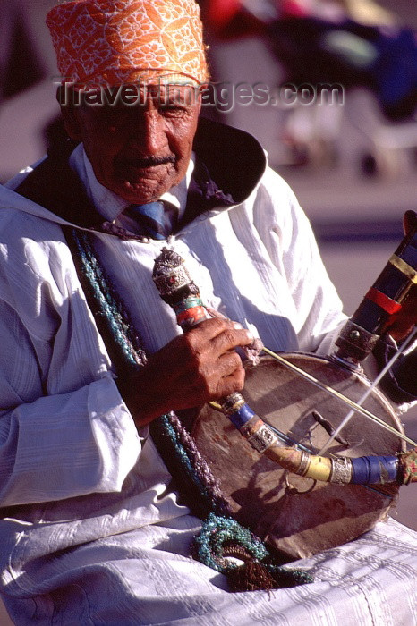 moroc1: Morocco / Maroc - Marrakesh: musician on the Place Djemaa el Fna - Moroccan musical instrument - rebab - photo by F.Rigaud - (c) Travel-Images.com - Stock Photography agency - Image Bank