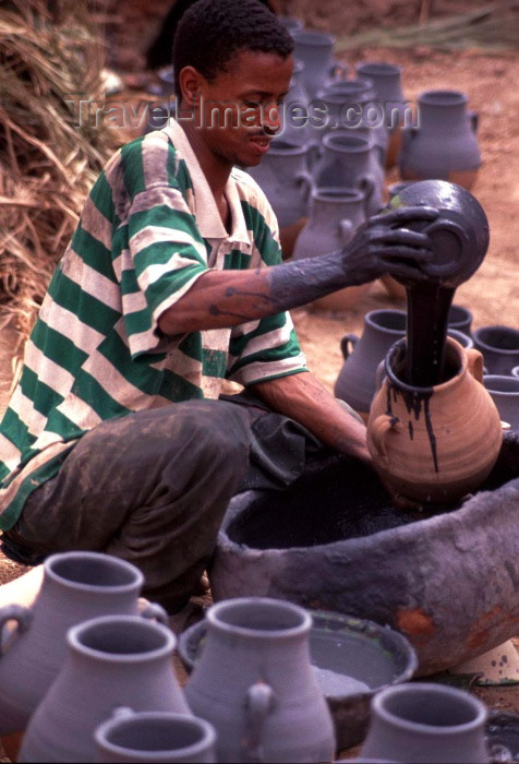 moroc134: Morocco / Maroc - Tamegroute: potter  at work - Moroccan artisan - photo by F.Rigaud - (c) Travel-Images.com - Stock Photography agency - Image Bank