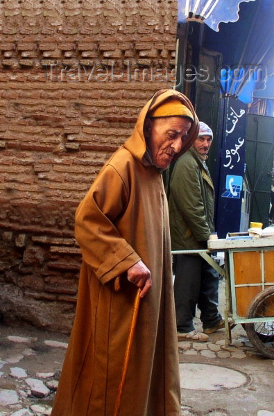 moroc164: Morocco / Maroc - Fez: man with a cane and jallaba - photo by J.Kaman - (c) Travel-Images.com - Stock Photography agency - Image Bank