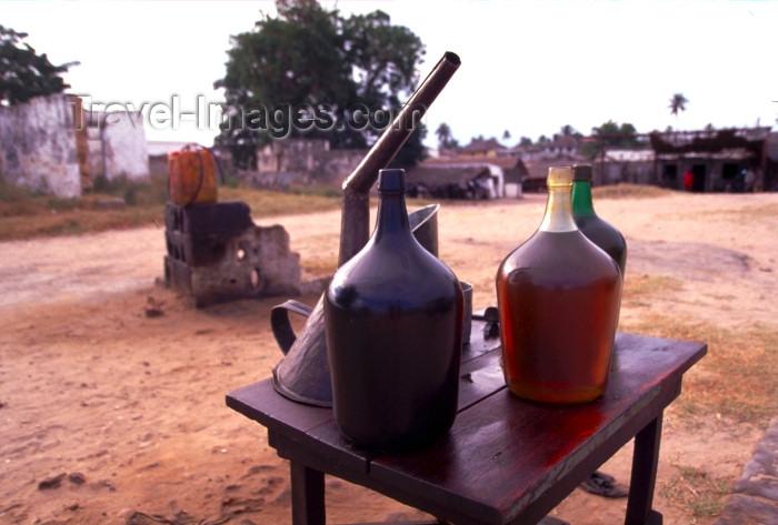 mozambique166: Ilha de Moçambique / Mozambique island: 'gas station' - bottles of gasoline / bomba de gasolina - photo by F.Rigaud - (c) Travel-Images.com - Stock Photography agency - Image Bank