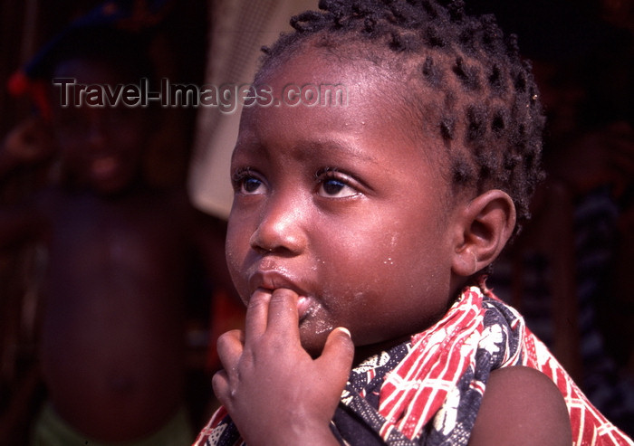 mozambique194: Pemba / Porto Amélia, Cabo Delgado, Mozambique / Moçambique: toddler with fingers in her mouth / criança com os dedos na boca - photo by F.Rigaud - (c) Travel-Images.com - Stock Photography agency - Image Bank