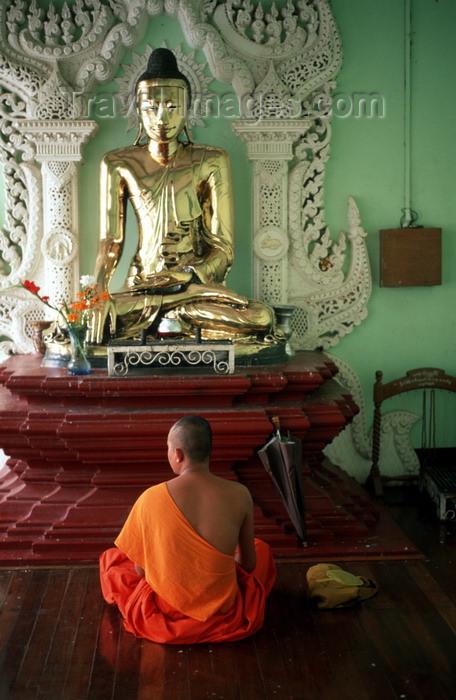 """myanmar201: Myanmar - Yangon: monk in meditation before a Buddha statue - religion - Buddhism - photo by W.Allgöwer - Meditation (lat. meditatio = """"das Nachdenken über"""" oder lat. medius = """"die Mitte"""") ist eine Konzentrationsübung mit dem Zweck, einen veränderten Bew - (c) Travel-Images.com - Stock Photography agency - Image Bank"""