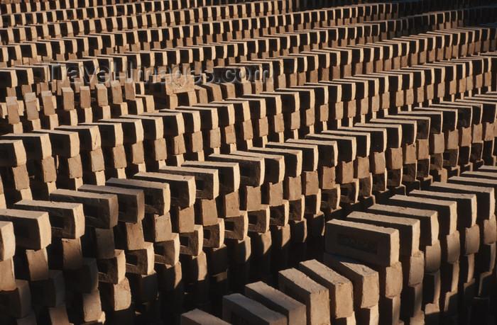 myanmar213: Myanmar - Bagan: drying in the sun - production of clay bricks - industry - Asia - photo by W.Allgöwer - Die Verwendung des Ziegels lässt sich in Vorderasien und auf dem indischen Subkontinent bis über fünftausend Jahre zurückverfolgen und gebrannte Lehms - (c) Travel-Images.com - Stock Photography agency - Image Bank