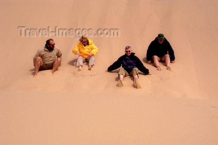 namibia140: Namibia: Four people sliding down Roaring Sand Dunes, Skeleton Coast - photo by B.Cain - (c) Travel-Images.com - Stock Photography agency - Image Bank
