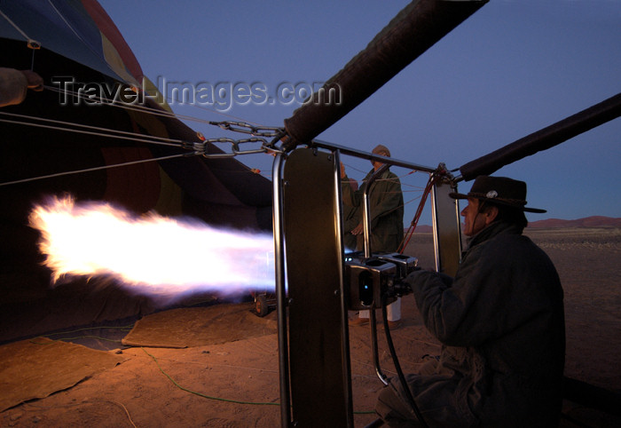 namibia153: Namibia: Hot Air Balloonride preparation - filling the balloon - flames, Sossusvlei - photo by B.Cain - (c) Travel-Images.com - Stock Photography agency - Image Bank