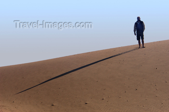 namibia164: Namibia: Man on sand dune casting long morning shadow, Skeleton Coast - photo by B.Cain - (c) Travel-Images.com - Stock Photography agency - Image Bank