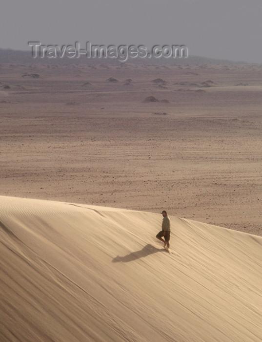 namibia165: Namibia: Man walking on sand dune, Skeleton Coast - photo by B.Cain - (c) Travel-Images.com - Stock Photography agency - Image Bank