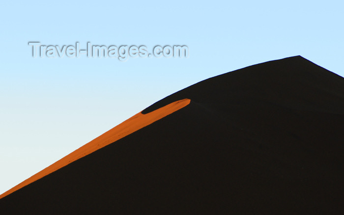 namibia167: Namibia Orange crescentslice silhouetted sand dune at sunrise, Sossusvlei - photo by B.Cain - (c) Travel-Images.com - Stock Photography agency - Image Bank