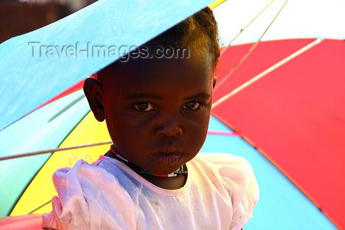 namibia192: Windhoek, Khomas Region, Namibia: a girl from Katatura - umbrella - photo by Sandia - (c) Travel-Images.com - Stock Photography agency - Image Bank