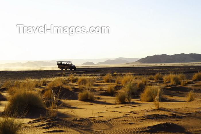 namibia197: Namib Desert - Sossusvlei, Hardap region, Namibia: travelling by 4wd at sunrise - Namib-Naukluft National Park - photo by Sandia - (c) Travel-Images.com - Stock Photography agency - Image Bank