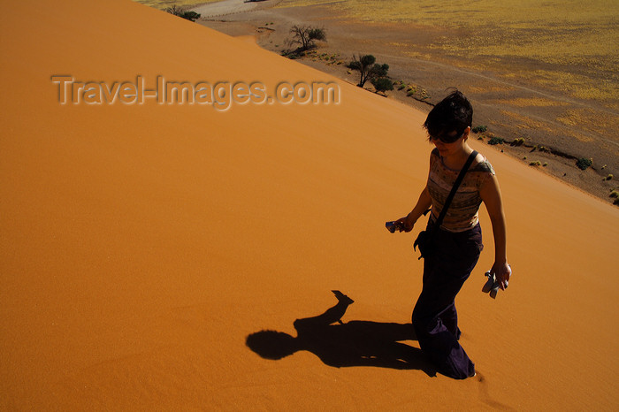 namibia206: Namib Desert - Sossusvlei, Hardap region, Namibia: traveller - sun and shadow - photo by Sandia - (c) Travel-Images.com - Stock Photography agency - Image Bank