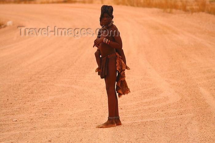 namibia229: Kunene region / Kaokoland, Namibia: Himba tribe - brothers on the road - photo by Sandia - (c) Travel-Images.com - Stock Photography agency - Image Bank