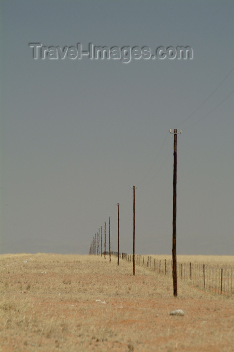 namibia26: Namibia: great expanse - endless phone line and fence - photo by J.Banks - (c) Travel-Images.com - Stock Photography agency - Image Bank