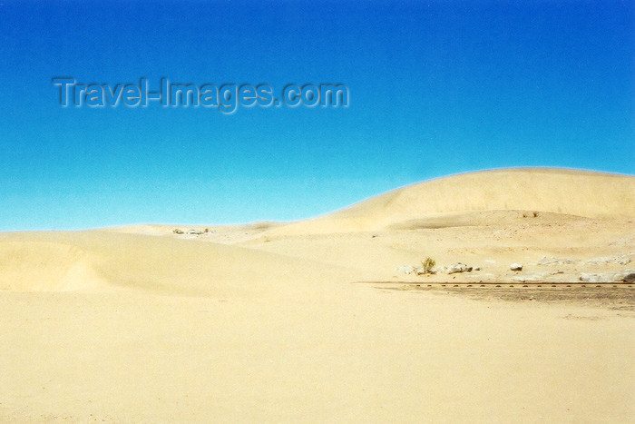 namibia6: Namibia - Swakopmund, Erongo region: railway track under the dunes - the desert advances - photo by J.Stroh - (c) Travel-Images.com - Stock Photography agency - Image Bank