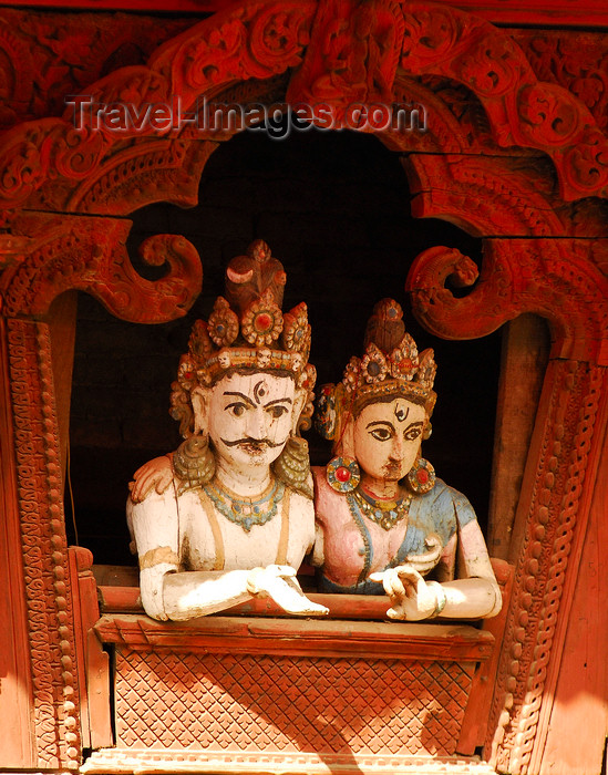 nepal148: Kathmandu, Nepal: wood statues of royal couple at the window, in a pose similar to Shiva and Parvati, in a pagoda temple roof strut, near Durbar Square - photo by E.Petitalot - (c) Travel-Images.com - Stock Photography agency - Image Bank