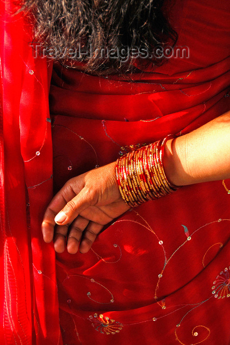 nepal201: Kathmandu, Nepal: red sari and bangle detail - photo by J.Pemberton - (c) Travel-Images.com - Stock Photography agency - Image Bank