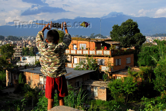 nepal215: Kathmandu, Nepal: boy flying a kite over the city - photo by J.Pemberton - (c) Travel-Images.com - Stock Photography agency - Image Bank