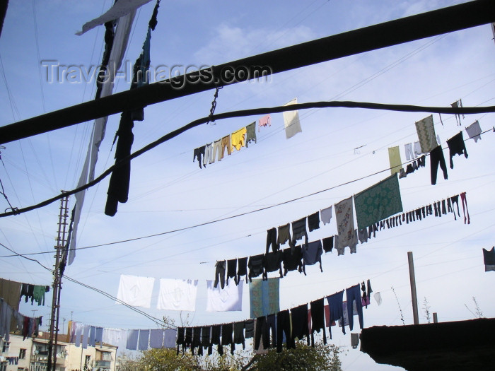 nk32: Nagorno Karabakh - Xankandi / Stepanakert: washing strung up between residential buildings - photo by A.Kilroy - (c) Travel-Images.com - Stock Photography agency - Image Bank